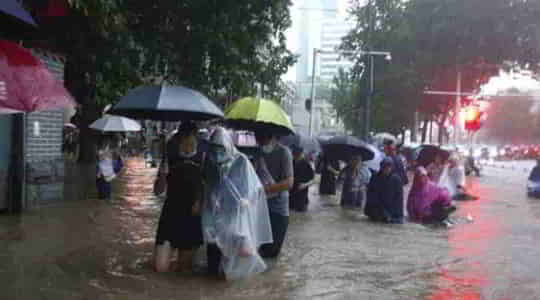 560359256China-is-experiencing-unprecedented-floods-with-25-people-killed-and-dams-damaged.jpg